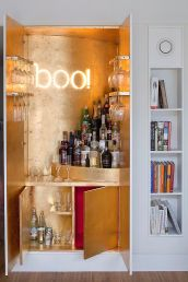 Gold-leaf-sheets-and-illuminated-sign-for-the-wardrobe-home-bar
